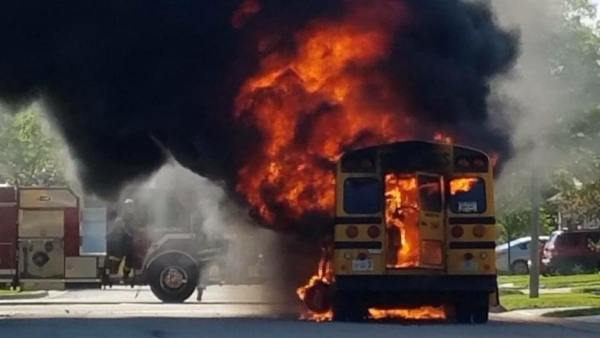 school bus engulfed in fire