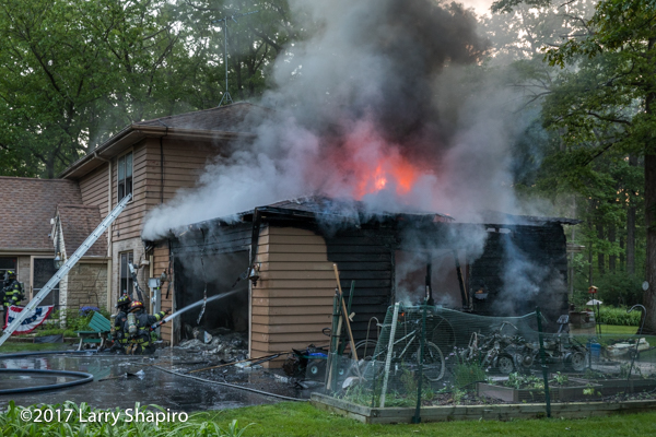 fire through roof of an attached garage