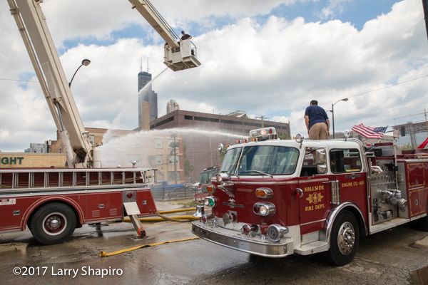 vintage fire trucks flowing water
