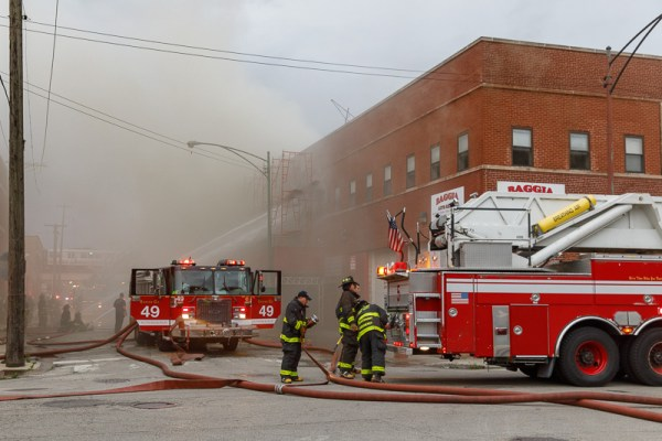 Chicago Firefighters and fire trucks at fire sene