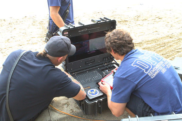 firefighters monitor sonar