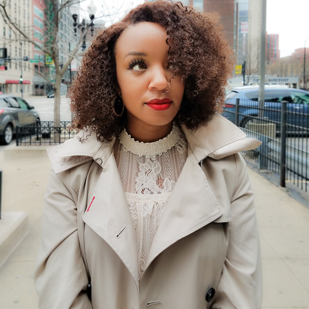 Kari Herrera of Chicagoings wearing a Tommy Hilfiger trench and lace top from Carson's