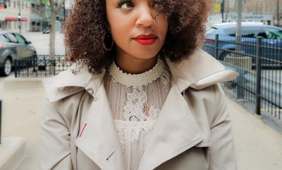 Kari wearing red lipstick and chic trench coat in downtown Chicago.