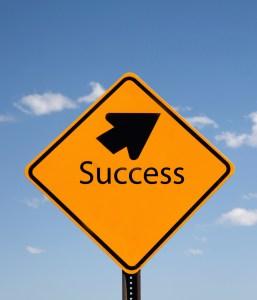 SuccessSign_Arrow_YellowBlackSky