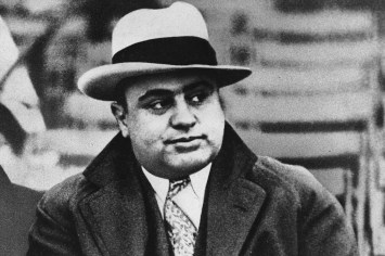 FILE - This Jan. 19, 1931, file photo shows Chicago mobster Al Capone at a football game. An intimate letter gangster Capone wrote while imprisoned at Alcatraz has sold at auction in Massachusetts. Boston-based RR Auction said the winning bid came Monday, Sept. 26, 2016, at an auction in Cambridge. (AP Photo/File)