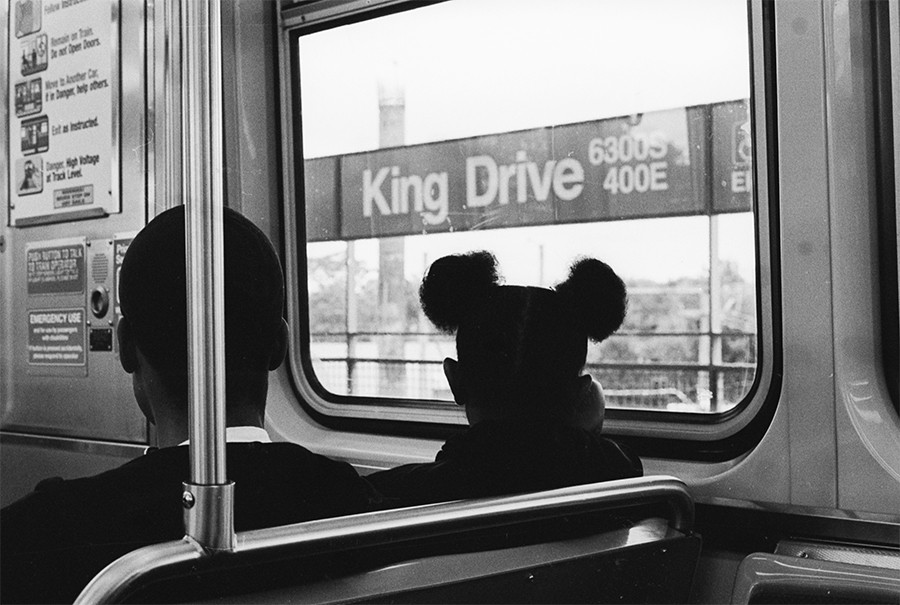 Patrons gaze out the window as the train pulls into King Drive.