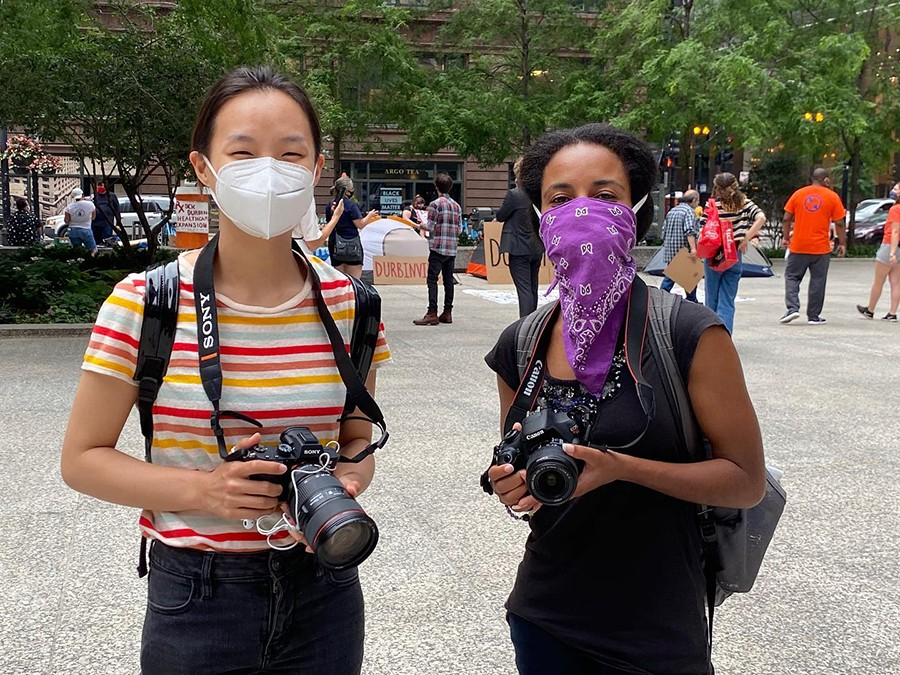 Filmmakers Lily Qi and Sarabi Woods covering events in downtown Chicago for Activism Now.