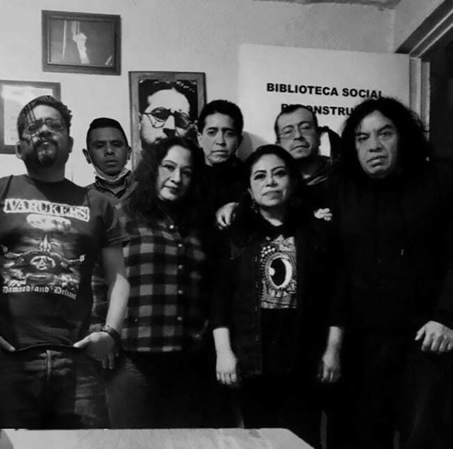 Volunteers at La Biblioteca Social Reconstruir in March. Back row: Luis, Omar, Kiko. Front: Patricio, Anna, Martha García, Helio. Library founder Ricardo Mestre Ventura is pictured at upper left.