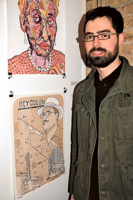 Artist Craighton Berman with his portrait of 35th Ward alderman Rey Colon