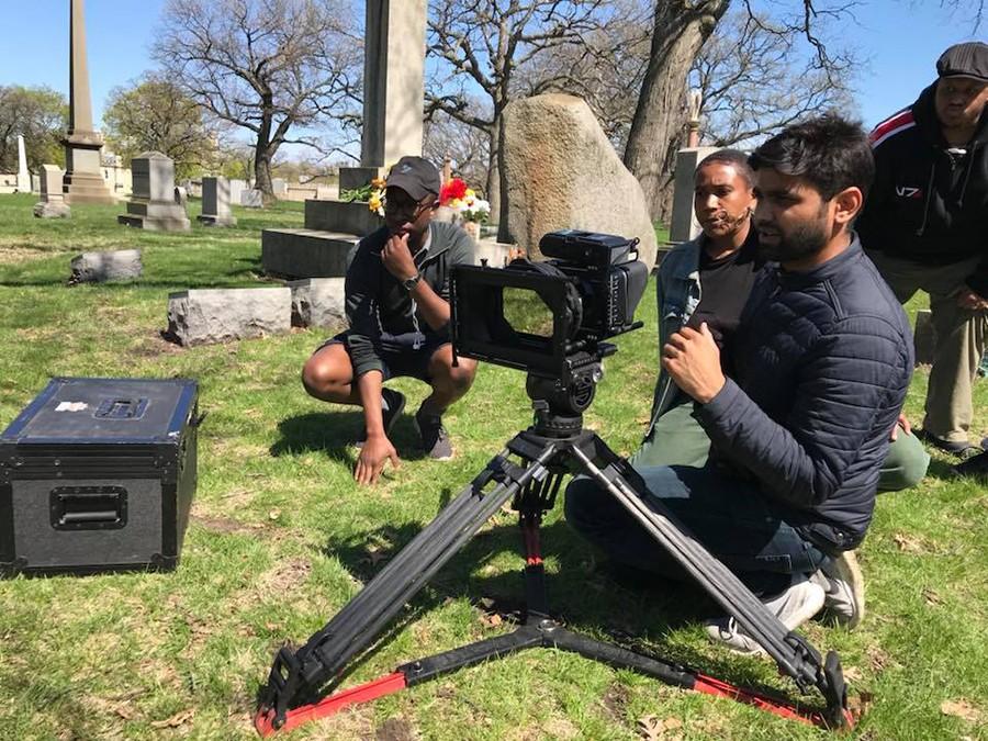 "Assistant cameraman Brandon White, director Jordan Rome, cinematographer Rinkesh Patel, and assistant director Spence Warren line up a shot for the short film ""365 TKA."""
