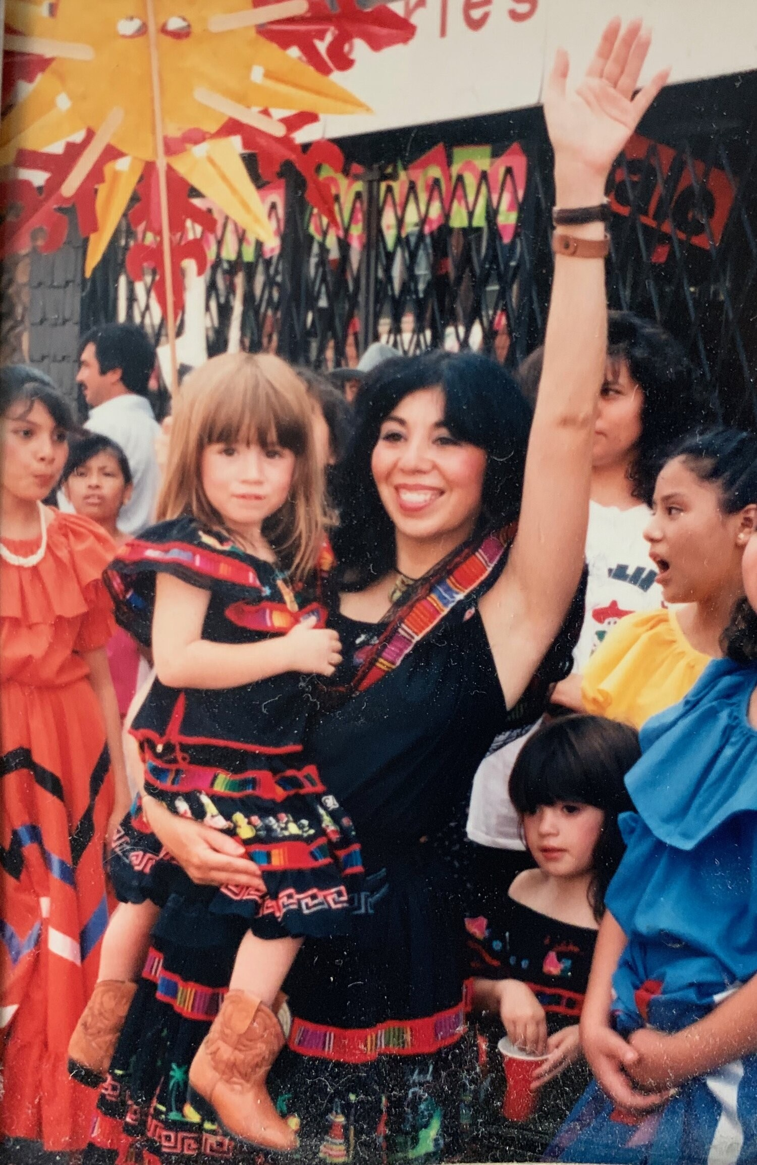 Emma Lozano holds her daughter Joline, as Tanya stands to her right