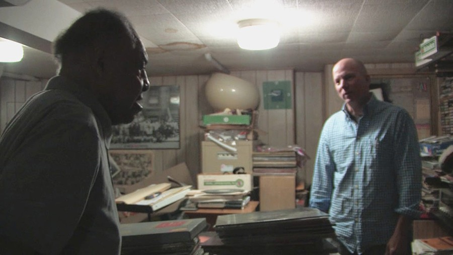 A still from the documentary: Dusty Groove owner Rick Wojcik (right) with jazz saxophonist and pharmacist Grady Johnson in Johnson's basement