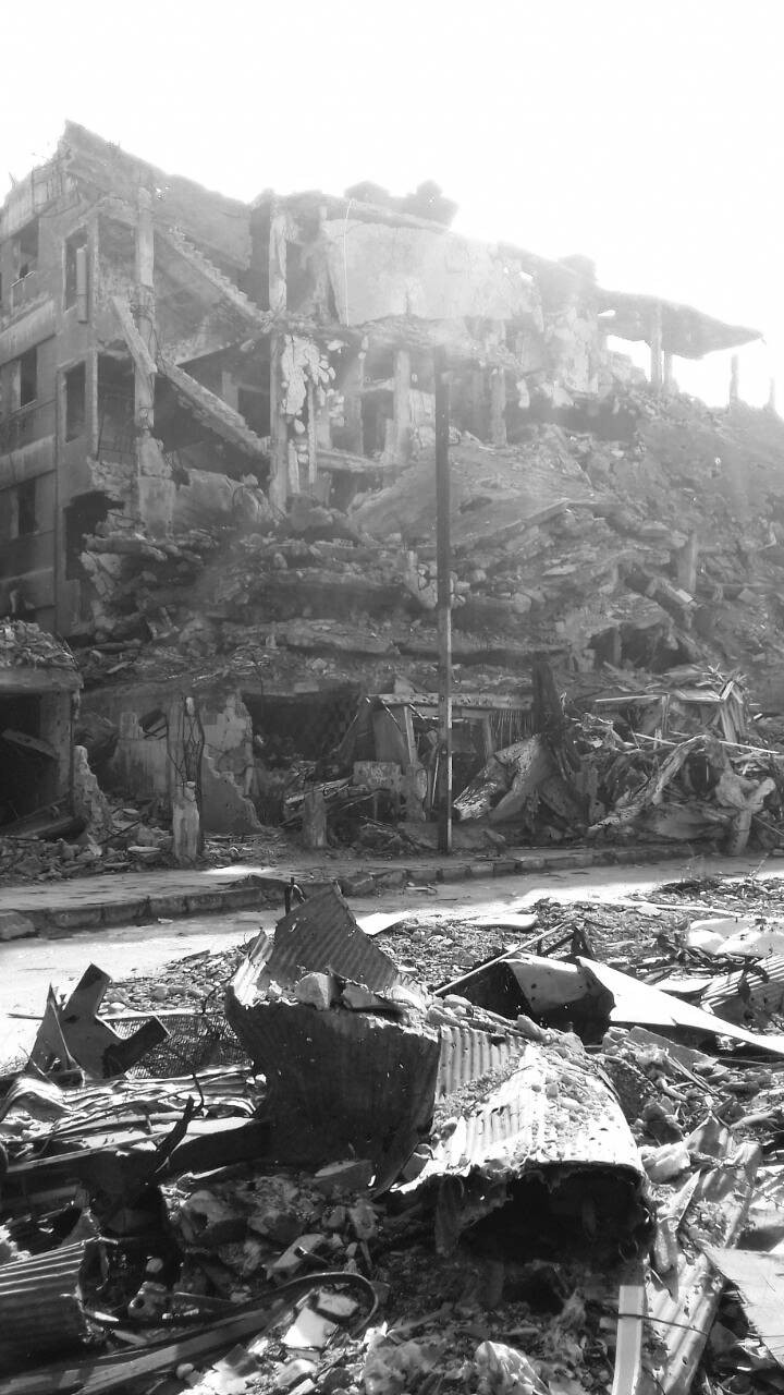Samar's parents' house, bombed after the family left for  Aleppo
