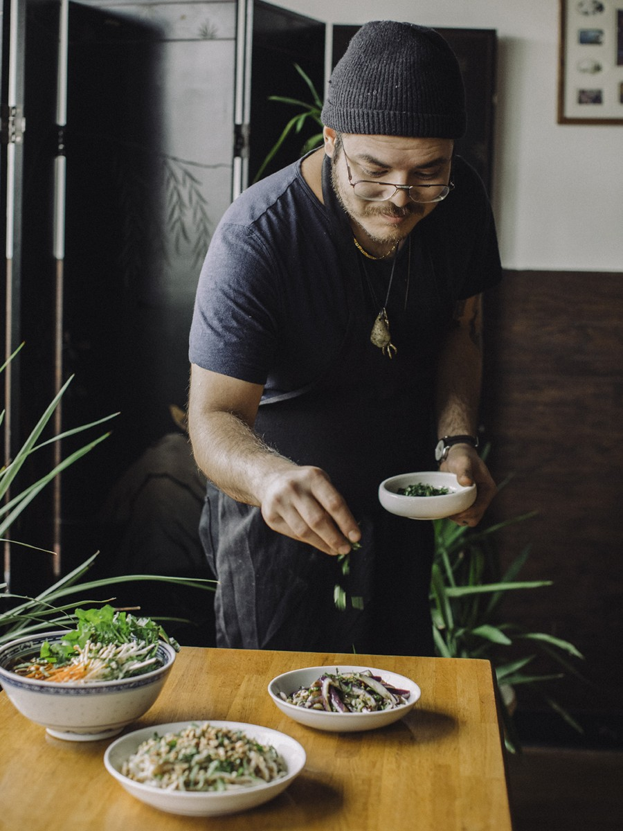 Eric Wat dresses some of Lao Peng You's non-dumpling dishes, which include cold steamed eggplant, cold noodles, and vegetarian noodle soup.