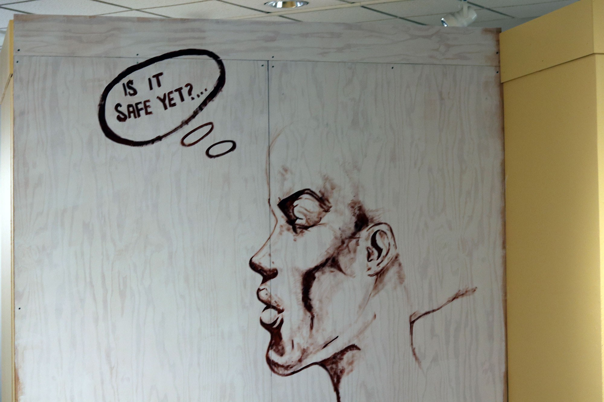 One of two murals in the new Black Creativity art and activism exhibit stands on the lower level of MSI, before invited students came to help finish it.