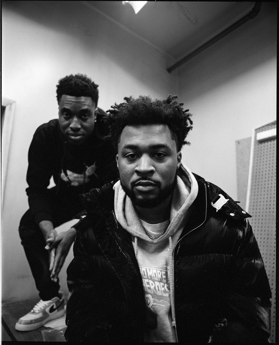 """Azeez """"Laka"""" Alaka and Brandon Holmes in their future office at No More Heroes headquarters in Little Village"""