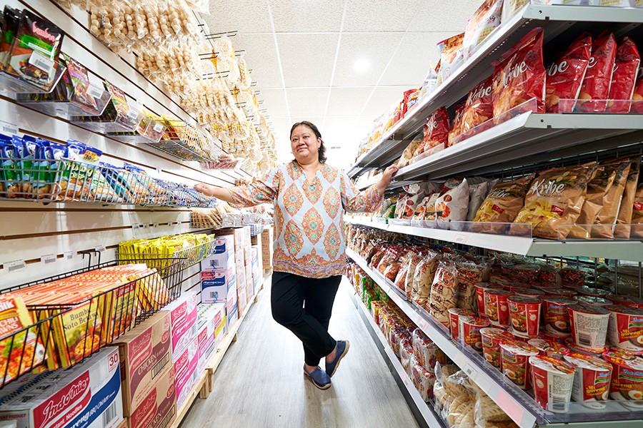 Tasya Hardono stocks close to 600 different items on the shelves at Waroeng in Schaumburg.