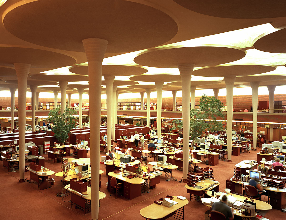 The Great Workroom of the Administration Building evokes a forest with its treelike columns and abundant natural light.