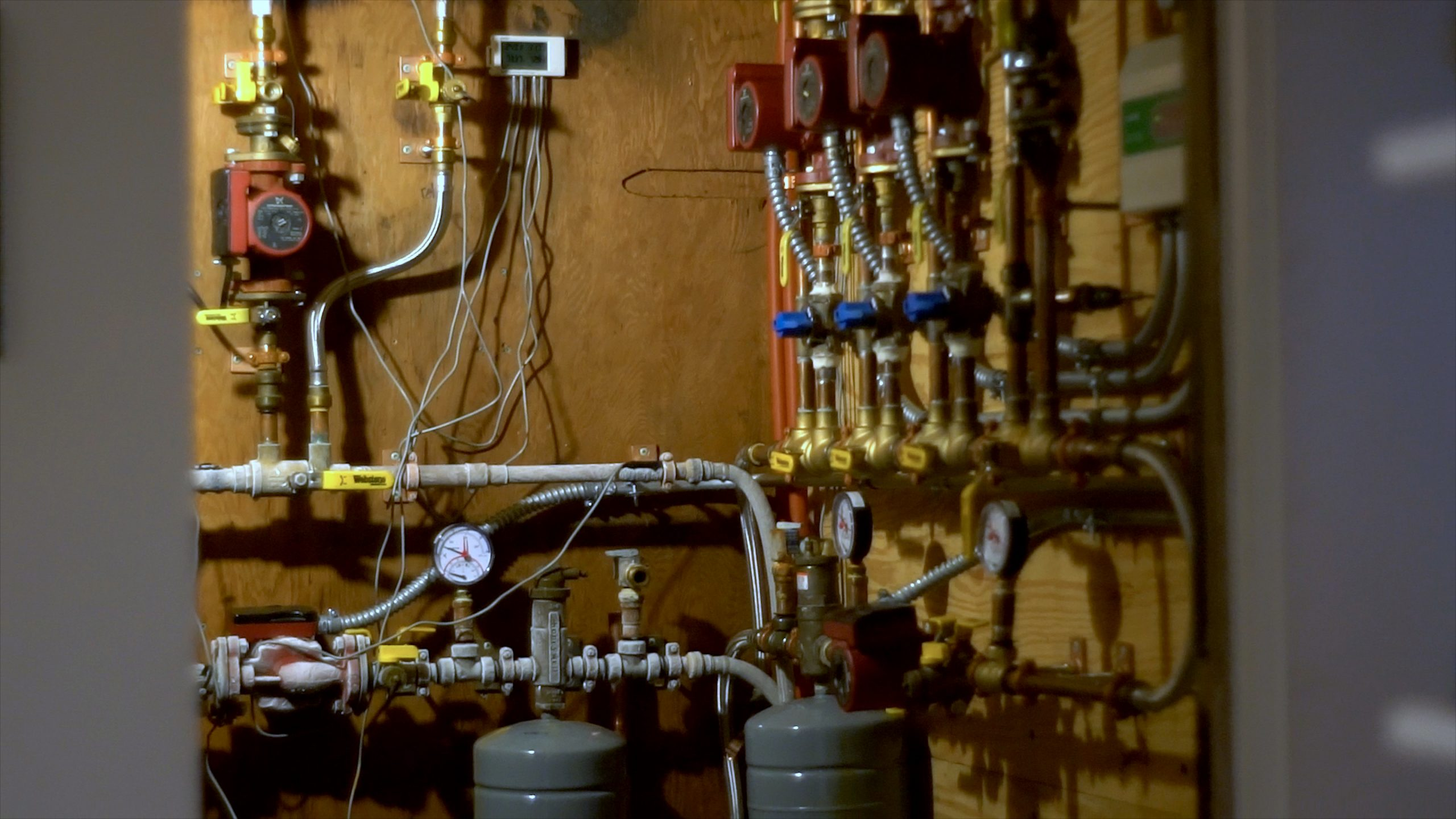 Pipes and gauges inside Tim Heppner's net-positive energy home in South Chicago