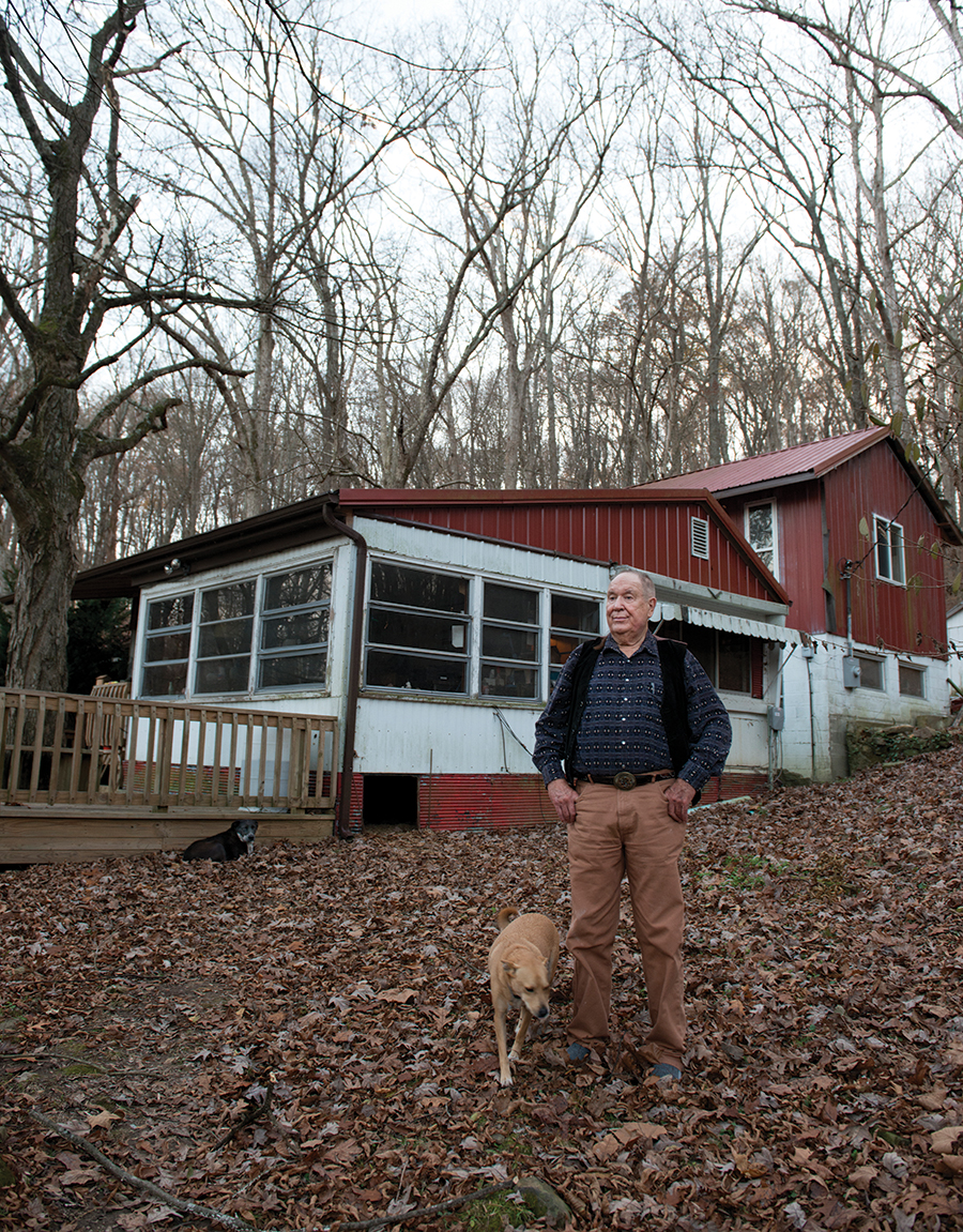 Barney Bush in front of his home on the Vinyard Indian Settlement