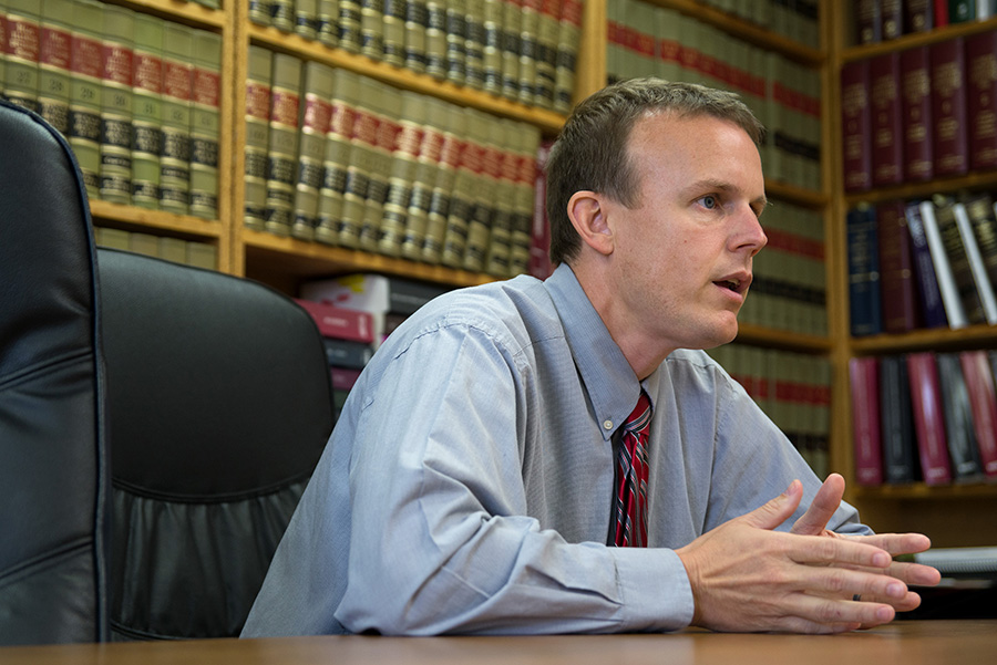 """Saline County State's Attorney Jayson Clark said he has a duty to respond when staff say they were assaulted by youth offenders at Illinois Youth Center in Harrisburg. """"I'm receiving reports of crimes occurring in my county, and I'm enforcing the law,"""" he said."""