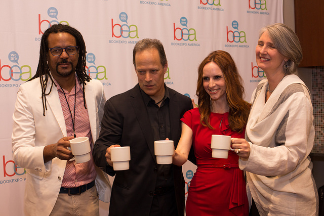 Colson Whitehead, Sebastian Junger, Faith Salle, and Louise Penny toast at the end of their author breakfast on Thursday morning.