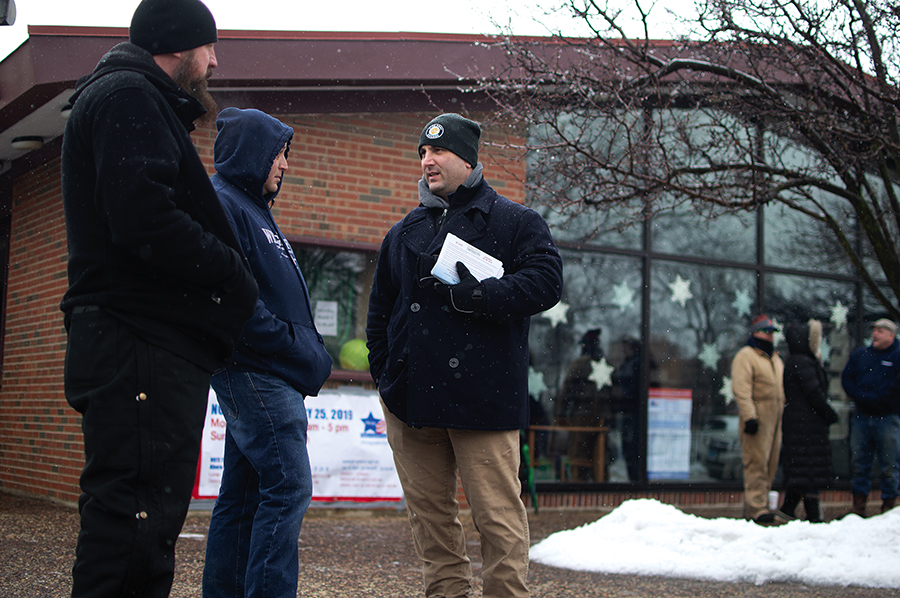 Anthony Napolitano greets early voters in Norwood Park.