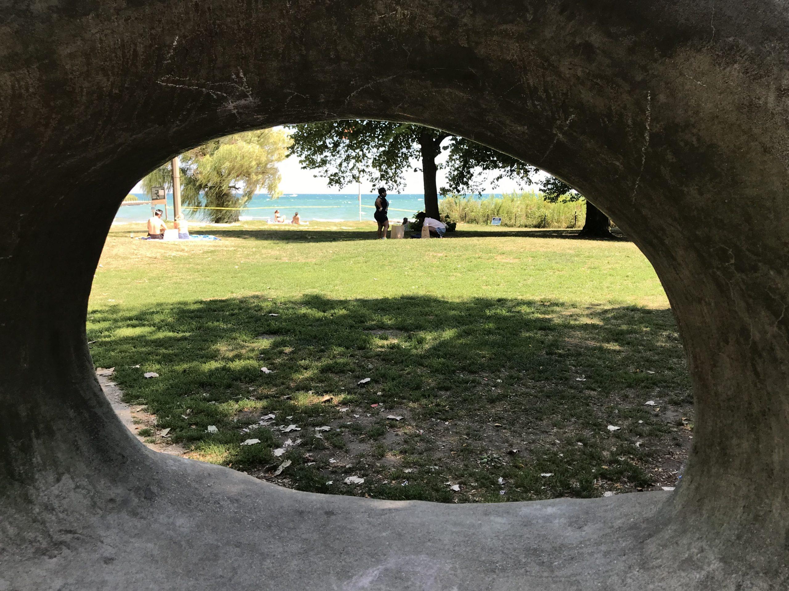 "Loyola Beach, seen through Lynn Takata's ""Waveform"" sculpture at Pratt Boulevard"