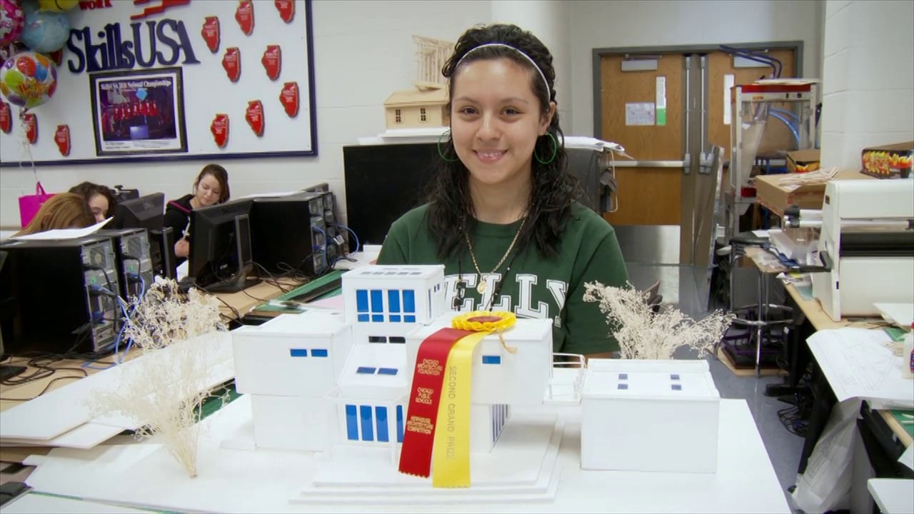 Maria presents an architectural design project in <i>In the Game</i>.
