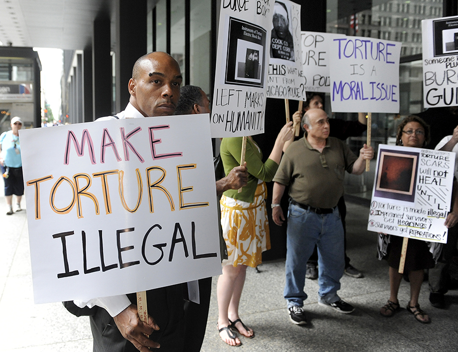 6-26-2010  Torture victim Mark Clements (L)  demonstrates with others from Illinois Coalition Against Torture outside the Federal Building after the Jon Burge guilty verdict.  (photo added 2018)