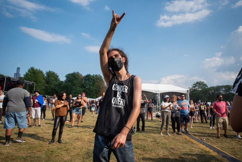 A masked-up Arakel Khaligian throws horns while watching La Armada's set at Ruido Fest on Friday, August 20, 2021.