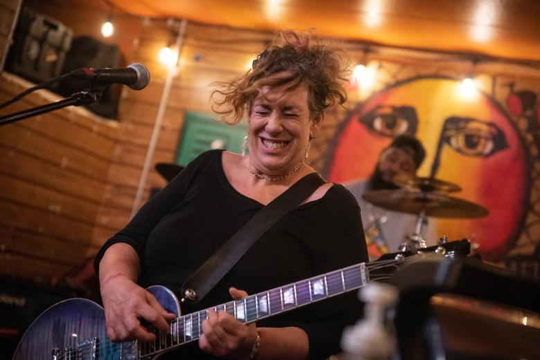 Blues guitarist Joanna Connor plays an early-morning set on August 20, 2021.