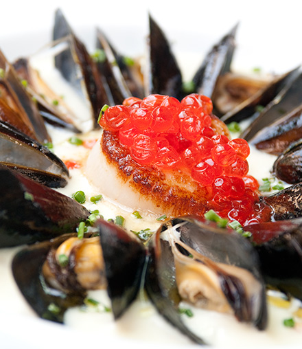 In a simple but satisfying fisherman's stew, salmon roe sits atop a perfectly cooked scallop.