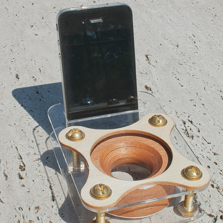 An iPhone speaker amp by Baine Rydin Ma made of wood, the better to hear yew with