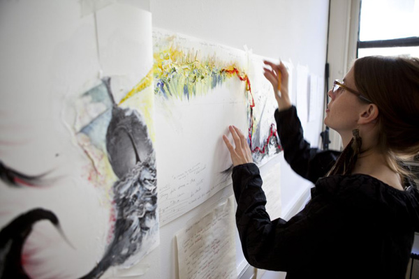 Anna Clyne works on the abstract paintings she made to help her compose <i>Night Ferry</i>.