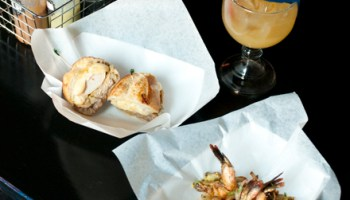 Chicken torta (with bread that's less hamburger bun than baguette—crisp and chewy and fantastic), Gomez shrimp (a dish not as intriguing as it sounds), and Billy's Beerita (perfectly inoffensive).