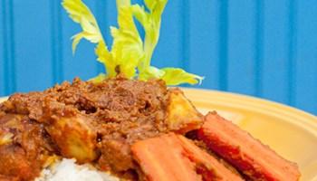 "Badara ""Badou"" Diakhate's <em>mafe</em>, a peanut-based stew with fat chunks of chicken and lamb"