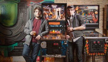 Philip Tibitoski (left, at Emporium) and Ben Perez (right, at Logan Arcade) give a lean to a Twilight Zone pinball machine. Pretty eerie, right?