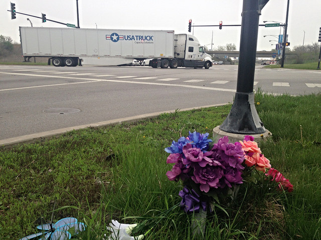 A roadside memorial at Woodlawn and 103rd, a wide road with fast traffic that leads to Big Marsh. A local man was killed here in a May 2015 car crash.