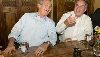 President George Bush shares a laugh at the Chicago Firehouse Restaurant with Mayor Daley.