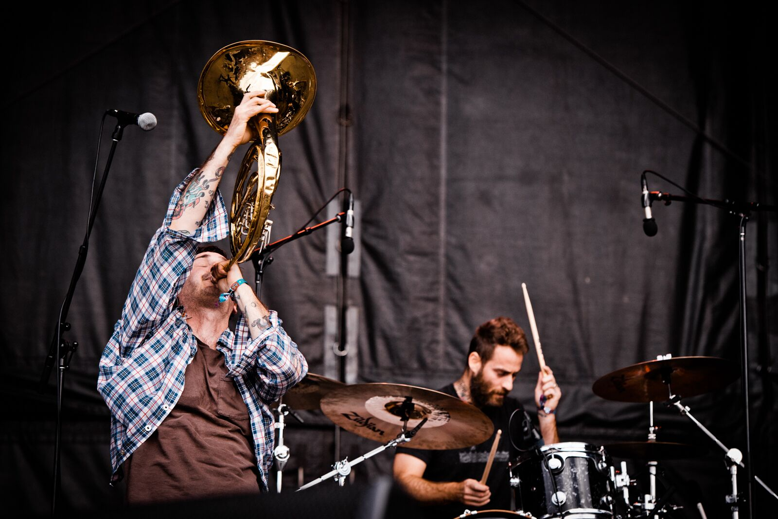 Tim Kinsella blowing into a French horn