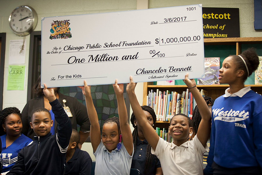 Beaming Westcott Elementary School students hold up the check from Chance.