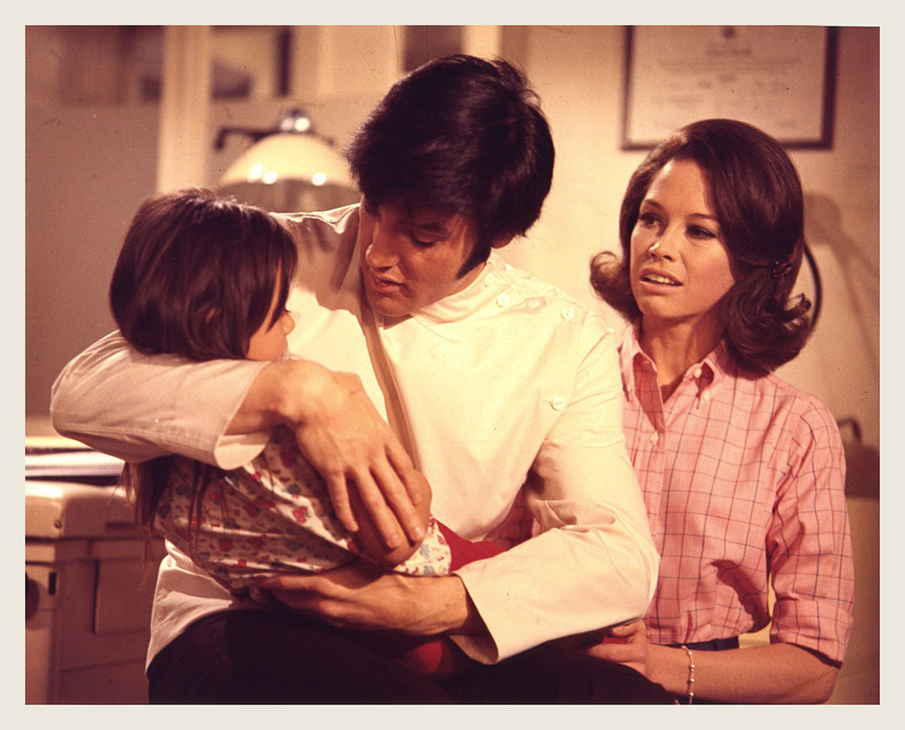 Dr. Elvis and Sister Mary Tyler Moore performing a miracle cure