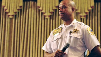 Eric Carter, commander of the Sixth police district, addresses residents in Chatham after telling them Superintendent Garry McCarthy couldn't make it.