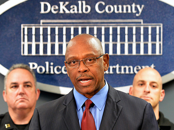 Alexander at a press conference in 2014. His critics say that in his nearly three years in DeKalb he has moved slowly in enacting locally the same reforms he's recommended to other departments nationally.
