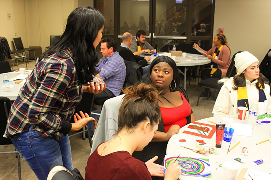 CHIL staff and youth participate in a painting activity hosted by the One Heart One Soul traveling art program.