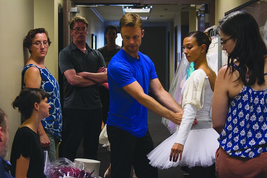 Wheater looks on as <i>Nutcracker</i> choreographer Christopher Wheeldon (center) helps fit Joffrey Ballet dancer Anais Bueno.