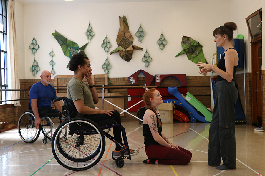 """Lenzo instructs Robby Williams in a duet at the Academy of Movement and Music in Oak Park. Williams, a former tango dancer, lost his lower-body functions in 2018 from gun violence. Lenzo helps him to gain more mobility on the wheel chair. """"I look forward to being a resource for him,"""" said Lenzo."""
