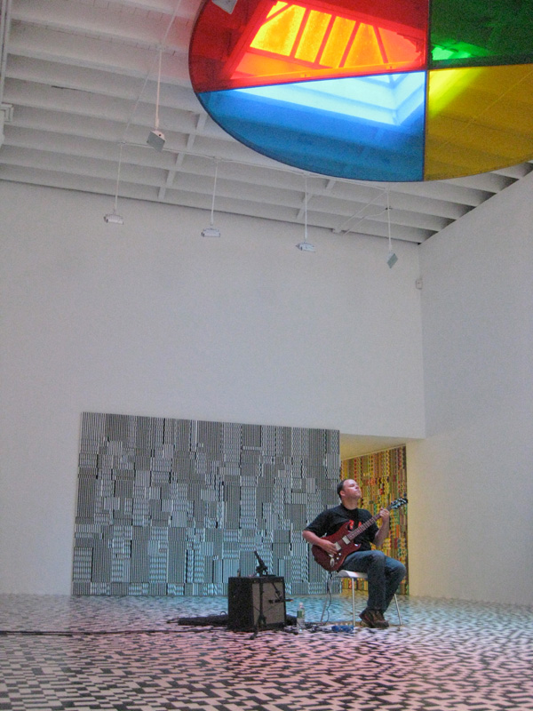 David Grubbs plays solo at New York's Deitch Projects gallery, beneath Peter Coffin's 2008 work <em>Untitled (Color Wheel)</em>.