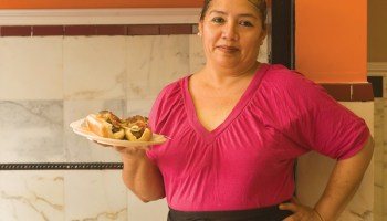 Blanca Diaz with Mexican hot dogs at Delicias Mexicanas